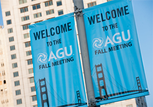 """A photograph of a blue street sign in San Francisco that reads """"Welcome to the AGU Fall Meeting"""""""