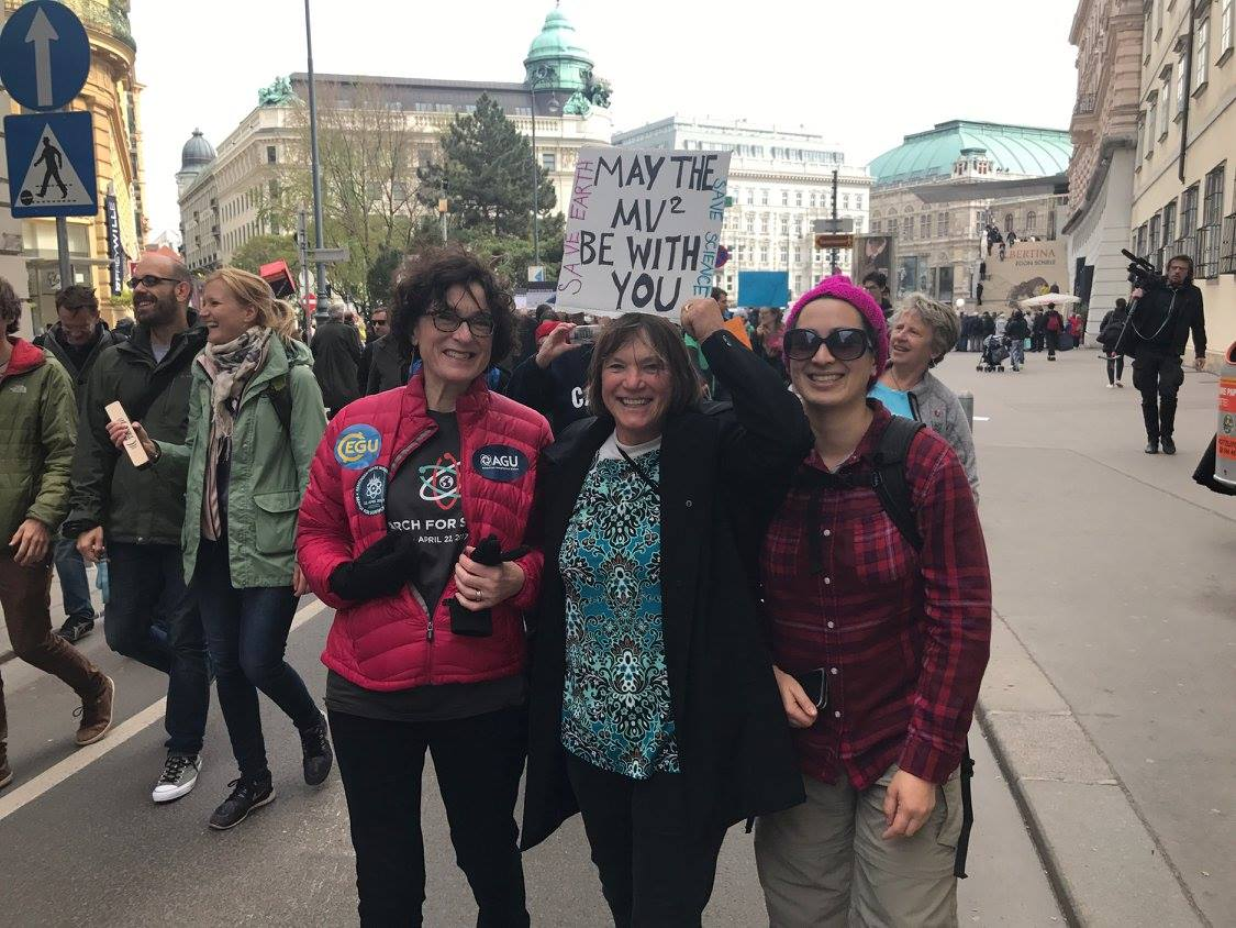 Photo of Chris McEntee with two women at the March for Science Vienna